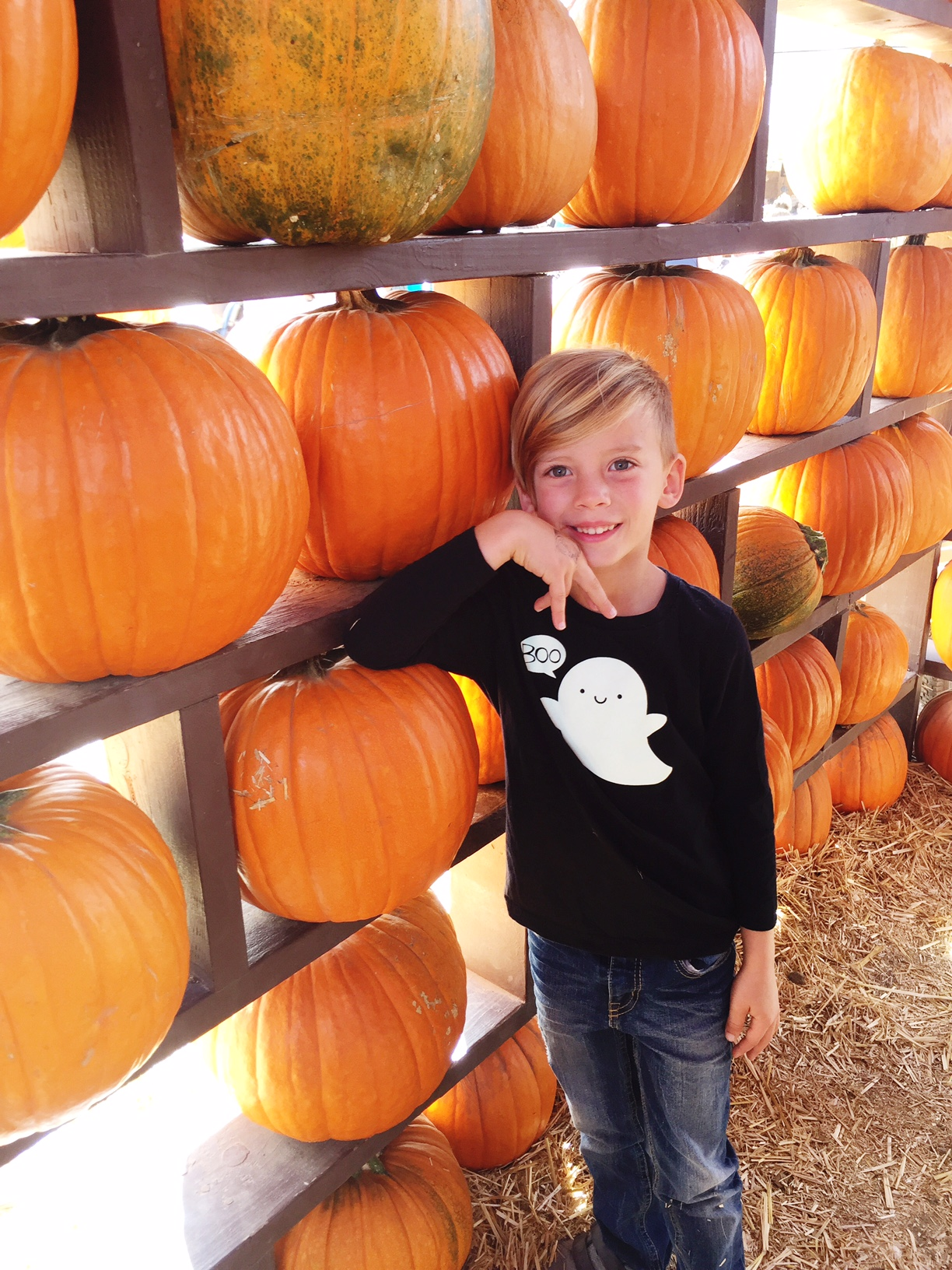 cute kid in whistle and flute halloween tee pumpkin patch fall photo